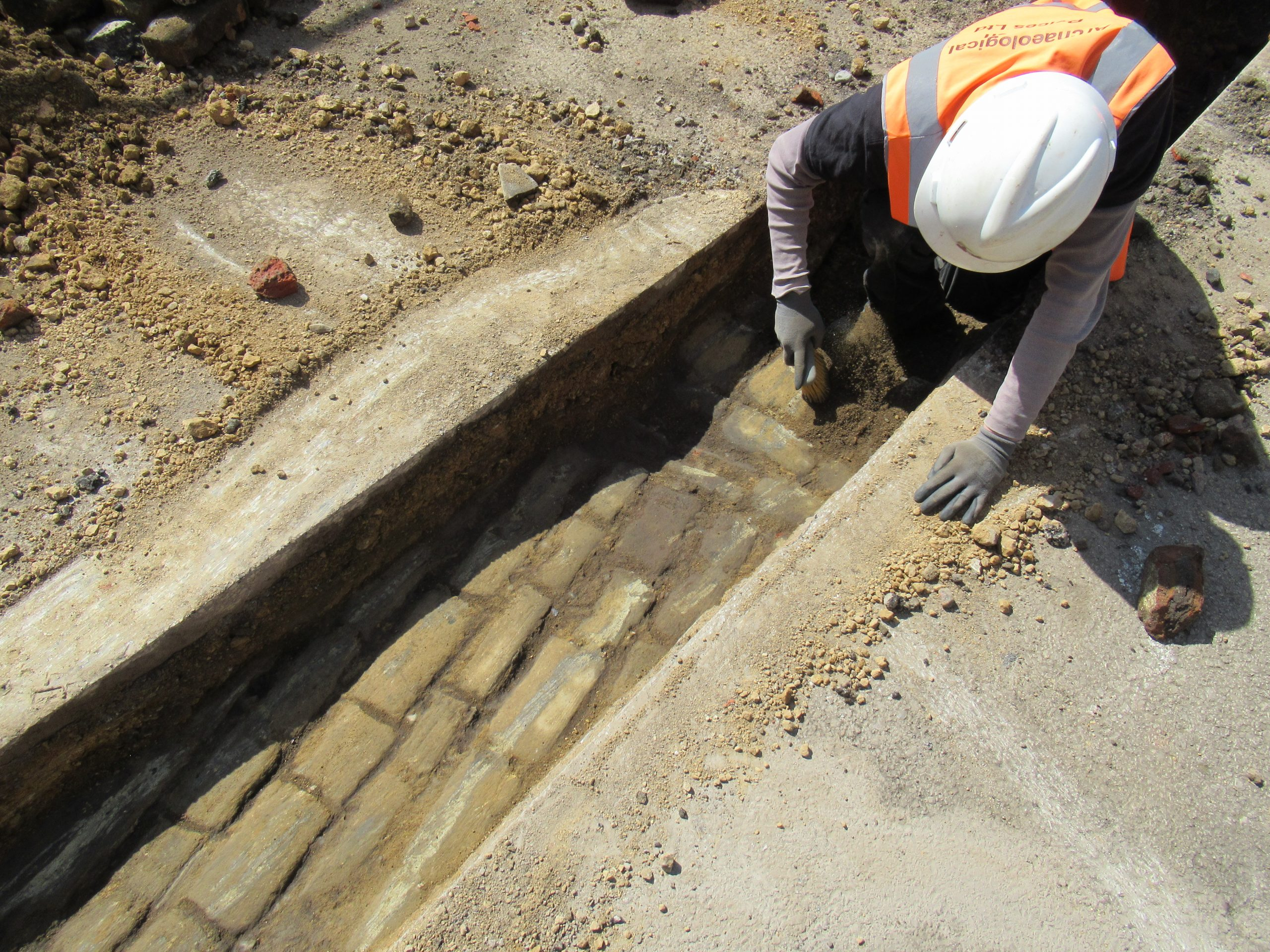 23rd April 2021 uncovering cobbles archaeologist on site recording finds